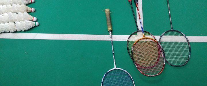 Badminton equipment. Badminton rackets, shuttlecocks on a badminton court