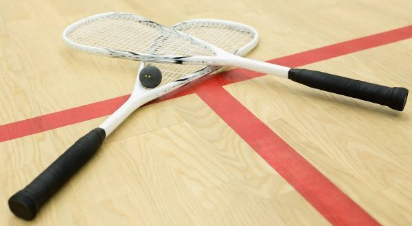 Squash rackets & squash ball on a squash court