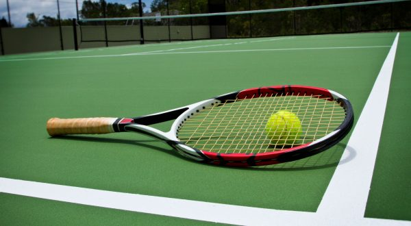 Tennis racket & tennis ball on tennis court